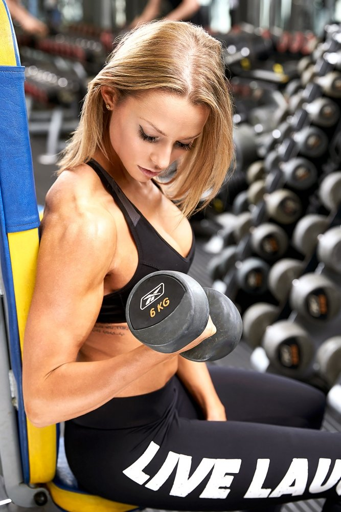 Woman gym weight training workout