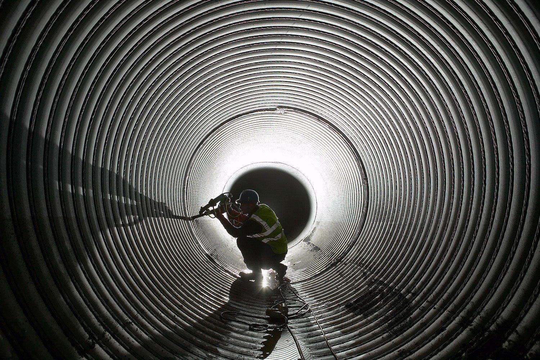 worker works underground in a sewer
