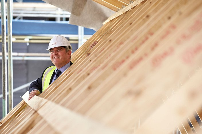 housing minister looks around house