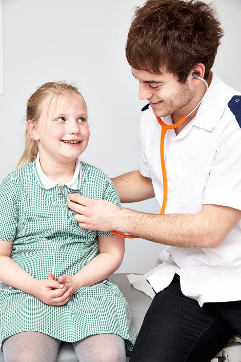 Doctor works with a young patient